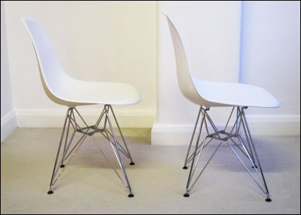 Vitra and Chinese reproduction white plastic chairs side by side