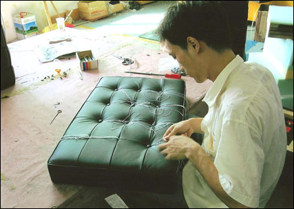 Studio sofa cushions being made by hand