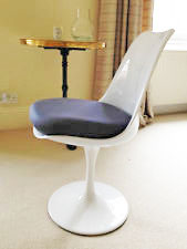 Trumpet chair with black seat pad