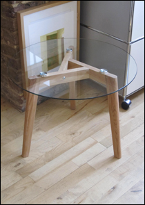 Tripod glass coffee table